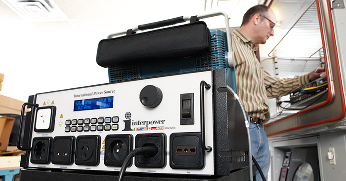 image of man using the interpower international power source to test his export products